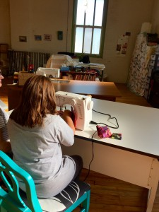 Ava is taking an introductory sewing class at Hot Shops in Kris Khan's studio.